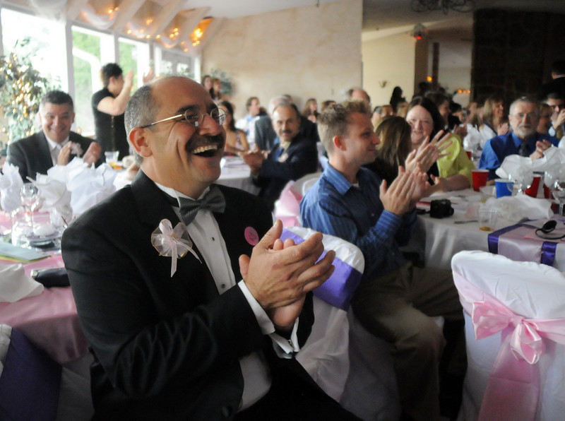 Alfonso Ramirez claps as he watches his daughter Antonia dance the waltz during Antonia's Quinceanera.<br /> <br /> September 4, 2010<br /> staff photo/David R. Jennings