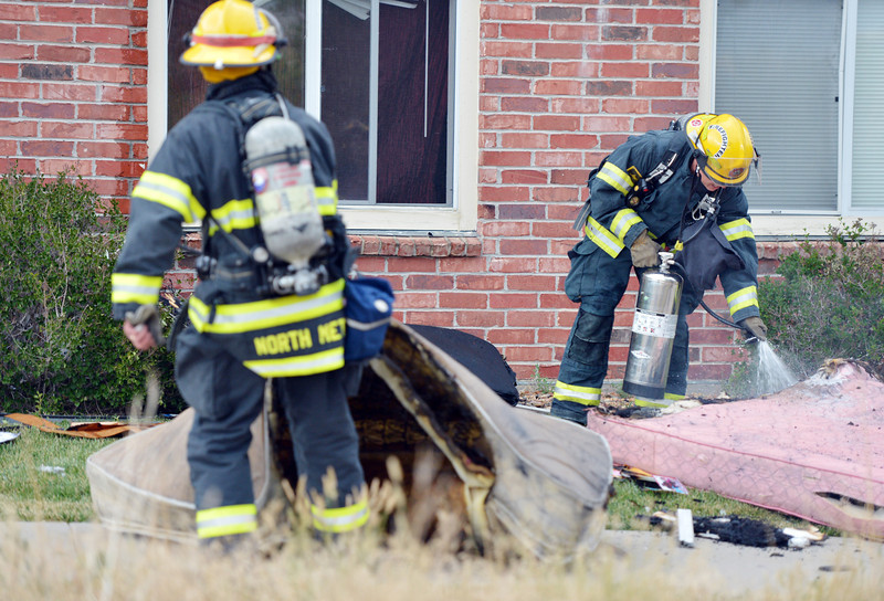 """North Metro Fire Rescue firefighters put out  burning mattresses from a third story apartment that was on fire, Wednesday, in the Willow Run Village, 12601 Zuni St.<br /> <br /> June27, 2012<br /> staff photo/ David R. Jennings<br /> <br /> for more photos  please go to  <a href=""""http://www.broomfieldenterprise.com"""">http://www.broomfieldenterprise.com</a>"""