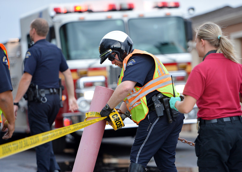 """Broomfield Police cordon off the apartment building after a third story apartment  fire a the Willow Run Village, 12601 Zuni St on Wednesday.<br /> <br /> June27, 2012<br /> staff photo/ David R. Jennings<br /> <br /> for more photos and video please go to  <a href=""""http://www.broomfieldenterprise.com"""">http://www.broomfieldenterprise.com</a>"""