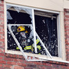 "A North Metro Fire Rescue firefighter breaks out the window of a third story apartment that was on fire at the Willow Run Village, 12601 Zuni St. on Wednesday.<br /> <br /> June27, 2012<br /> staff photo/ David R. Jennings<br /> <br /> for more photos and video please go to  <a href=""http://www.broomfieldenterprise.com"">http://www.broomfieldenterprise.com</a>"