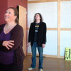 Broomfield artist Arlo White, right, and his wife Kim supervises the hanging of Arlo's show, Planet Rock, in the lobby of the Broomfield Auditorium on Friday.<br /> <br /> January 6, 2012<br /> staff photo/ David R. Jennings