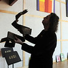Broomfield artist Arlo White lifts his sculpture, EEEL, to Chandra Bezjak for his show ,Planet Rock, in the lobby of the Broomfield Auditorium on Friday.<br /> <br /> January 6, 2012<br /> staff photo/ David R. Jennings