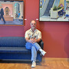 Artist David Griffin poses with some of his paintings  and sculptures on display in the lobby of the Audi on Saturday.<br /> <br /> February 2, 2013<br /> staff photo/ David R. Jennings