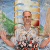 Artist David Griffin poses with his painting Raigo to show his painting is designed for the viewer interact with on display in the lobby of the Audi on Saturday.<br /> <br /> February 2, 2013<br /> staff photo/ David R. Jennings