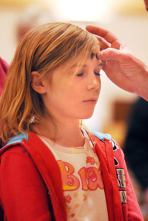 Emily Isaacson, 8, receives ashes from Pastor Scott McAnally during the Lutheran Church of Hope children's Ash Wednesday service.<br /> <br /> February 17, 2010<br /> Staff photo/David R. Jennings