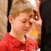 Anthony Moller, 9, receives ashes from Pastor Scott McAnally during the Lutheran Church of Hope children's Ash Wednesday service.<br /> <br /> February 17, 2010<br /> Staff photo/David R. Jennings