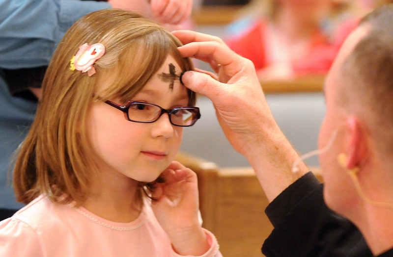 Lily Roth, 6, receives ashes from Pastor Scott McAnally during the Lutheran Church of Hope children's Ash Wednesday service.<br /> <br /> February 17, 2010<br /> Staff photo/David R. Jennings