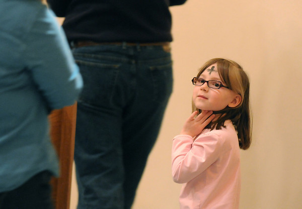 Lily Roth, 6, looks back to her parents after receiving ashes from Pastor Scott McAnally during the Lutheran Church of Hope children's Ash Wednesday service.<br /> <br /> February 17, 2010<br /> Staff photo/David R. Jennings