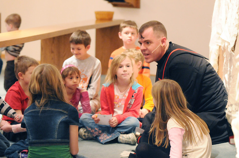 Pastor Scott McAnally, right, chats with children  during the Lutheran Church of Hope children's Ash Wednesday service.<br /> <br /> February 17, 2010<br /> Staff photo/David R. Jennings