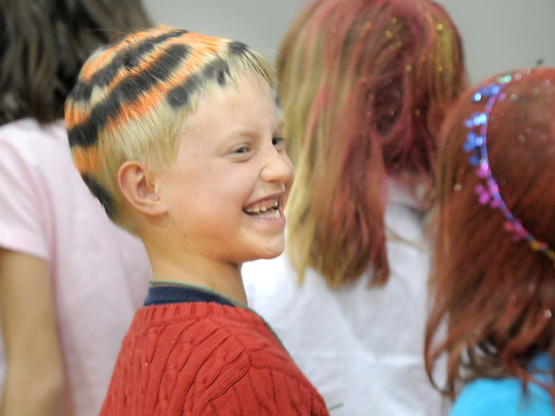 Griffin Craig, 7, is all smiles after having his hair done at the crazy hair booth during the Aspen Creek K-8 Fall Festival on Friday. <br /> November 5, 2010<br /> staff photo/David R. Jennings