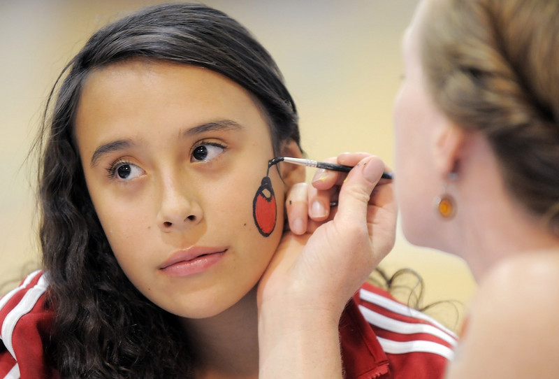 Riley Merrill, 12, left, has her face painted by Kate Hudson during the Aspen Creek K-8 Fall Festival on Friday. <br /> November 5, 2010<br /> staff photo/David R. Jennings