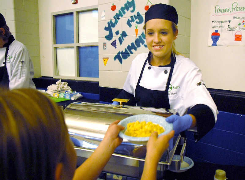 Kelly Baum, Broomfield High Pro Start student, serves the popular Mac & cheese dish for children participating in the Aspen Creek K-8 Fall Festival on Friday. <br /> November 5, 2010<br /> staff photo/David R. Jennings