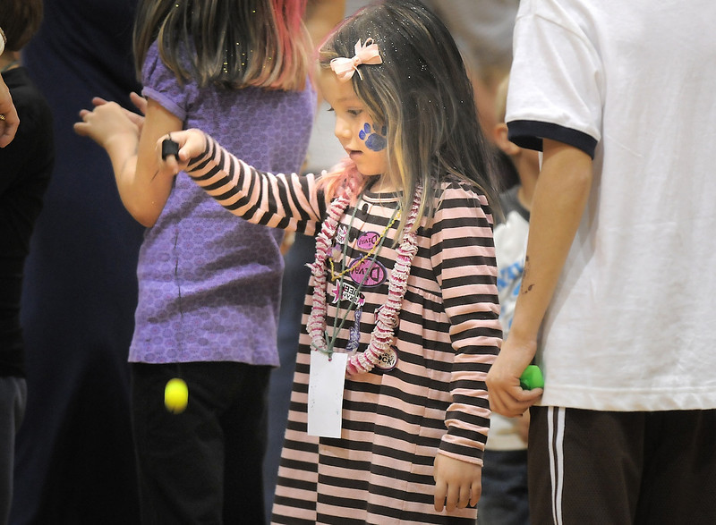 Allison Merlino, 4, plays with a ball and string while waiting in line for the lollypop trees game during the Aspen Creek K-8 Fall Festival on Friday. <br /> November 5, 2010<br /> staff photo/David R. Jennings