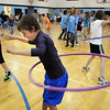 Third grader Bryce Laude works to keep his hula hoop going during Aspen Creek's 10th anniversary celebration assembly on Friday.<br /> May 21, 2010<br /> Staff photo/ David R. Jennings