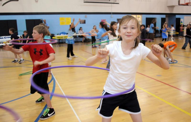 Third grader Gretta Barrington twirls the hula hoop during Aspen Creek's 10th anniversary celebration assembly on Friday.<br /> May 21, 2010<br /> Staff photo/ David R. Jennings