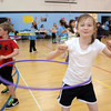 Third grader Gretta Barrington twirls the hula hoop during Aspen Creek's 10th anniversary celebration assembly on Friday.<br /> May 21, 2010<br /> Staff photo/ David R. Jennings