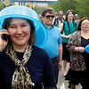 "Members of the new ""Society of blue buckets"" who wear blue buckets of all shapes and sizes as they gather in Moscow to take part in an unauthorized  flashmob event against flashing blue lights which became a symbol of powerful elite representatives whose cars break all traffic rules, Russia, on Sunday, May 2, 2010. Flashmob participants who several weeks ago formed a Society of blue buckets brought blue buckets of various size to imitate cars with flashing blue organizers of flashmob says that they decided to protest against ""the fact that all people are equal and some people are an exception"". (AP Photo/Mikhail Metzel)"