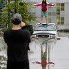 Britnie Turner stands on top of a submerged car as Nick Howell takes her picture on Sunday, May 2, 2010, in Nashville, Tenn. Seven people were killed in Tennessee and four in northern Mississippi by a line of storms that brought heavy flooding and tornados to the region over the weekend. (AP Photo/Mark Humphrey)