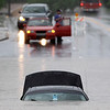 A submerged car sits in flood waters on Sunday, May 2, 2010 in Nashville, Tenn. Severe storms dumped heavy rain on Tennessee for the second straight day. (AP Photo/Mark Humphrey)