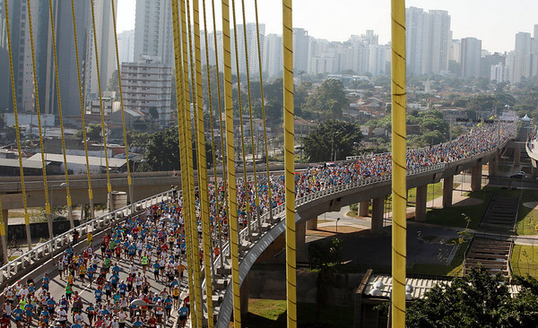 Athletes run the Sao Paulo International Marathon in Sao Paulo, Sunday, May 2, 2010. (AP Photo/Andre Penner)