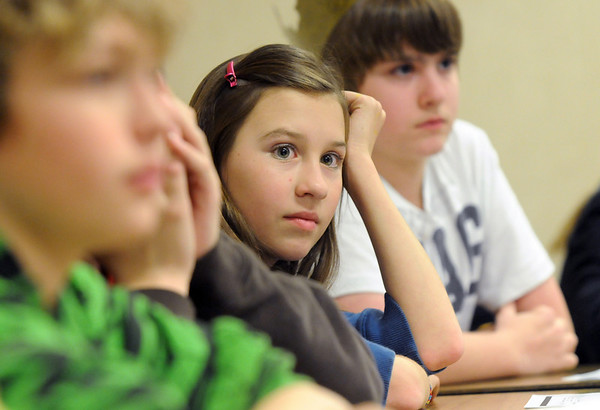 Eighth grader Kat Heboa waits for a question during Broomfield Heights Middle School geography bee  on Tuesday.<br /> December 8, 2009<br /> Staff photo/David R. Jennings