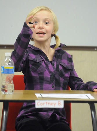 Sixth grader Cortney Blanton reacts after knowing the answer to a question during Broomfield Heights Middle School geography bee  on Tuesday.<br /> December 8, 2009<br /> Staff photo/David R. Jennings