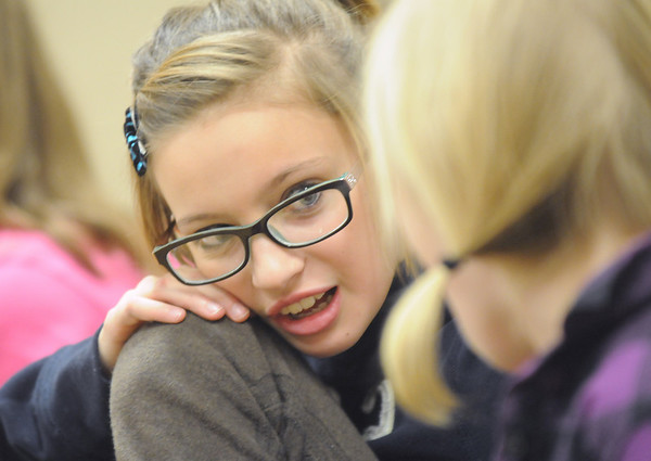 Sixth grader Ashley Fleming chats with Cortney Blanton as they wait for a question during Broomfield Heights Middle School geography bee  on Tuesday.<br /> December 8, 2009<br /> Staff photo/David R. Jennings