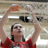 Haylie Castor, Crimson Crusaders, cuts the basketball net after winning the championship of the eighth-grade Roundball Rukus 2012 at  Broomfield Heights Middle School on Thursday.<br /> March 15,  2012 <br /> staff photo/ David R. Jennings