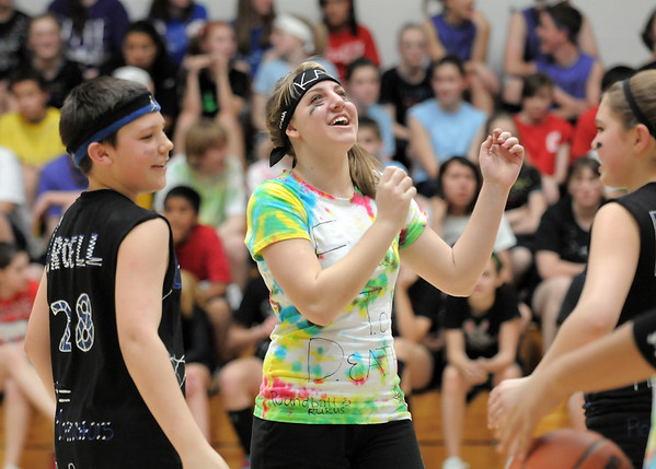 Kaley Vittoria, center, gives a cheer after her FTD team defeated the Hyerizers with Chad Croell, left, and Bailey Estes, right, during the eighth-grade Roundball Rukus 2012 at  Broomfield Heights Middle School on Thursday.<br /> March 15,  2012 <br /> staff photo/ David R. Jennings