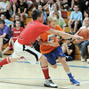 Brody Wristen, right, Linsanity, drives the bal around Noah Dohm, Crimson Crusaders, during the championship game in the eighth-grade Roundball Rukus 2012 at  Broomfield Heights Middle School on Thursday.<br /> March 15,  2012 <br /> staff photo/ David R. Jennings