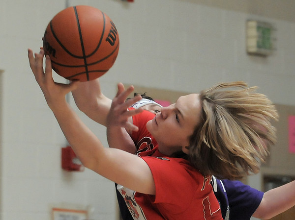 Connor Frantz, Crimson Crusaders, reaches for the ball going against Mason Alfrey, Grape Kool Aid, during the eighth-grade Roundball Rukus 2012 at  Broomfield Heights Middle School on Thursday.<br /> March 15,  2012 <br /> staff photo/ David R. Jennings