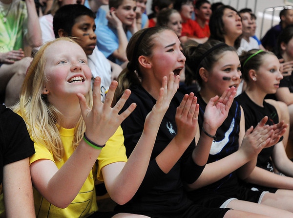 Greta Wolsleben, left, Bailey Patterson, and Bailey Estes cheer during the eighth-grade Roundball Rukus 2012 at  Broomfield Heights Middle School on Thursday.<br /> March 15,  2012 <br /> staff photo/ David R. Jennings