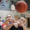 Connor Frantz, left, and Chase Arnold, Wolf Pack, go for the ball during the 8th grade Roundball Rukus 2012 at  Broomfield Heights Middle School on Thursday.<br /> March 15,  2012 <br /> staff photo/ David R. Jennings