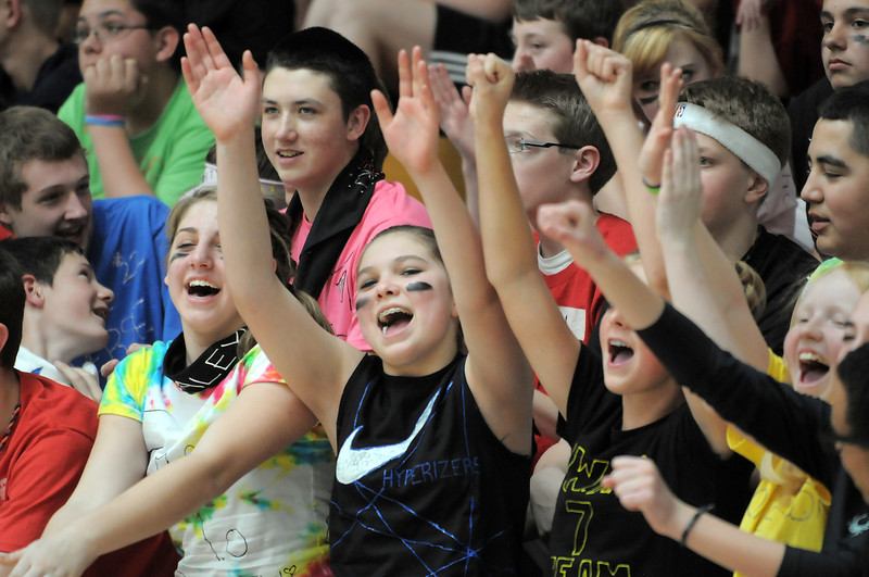 Kaley Vittoria, left, Bailey Estes, Makena Bambei, and Greta Wolsleben cheer on teams during the eighth-grade Roundball Rukus 2012 at  Broomfield Heights Middle School on Thursday.<br /> March 15,  2012 <br /> staff photo/ David R. Jennings
