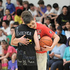Noah Dohm, right, gives a hug to Austin Amacher after a game during the eighth-grade Roundball Rukus 2012 at  Broomfield Heights Middle School on Thursday.<br /> March 15,  2012 <br /> staff photo/ David R. Jennings