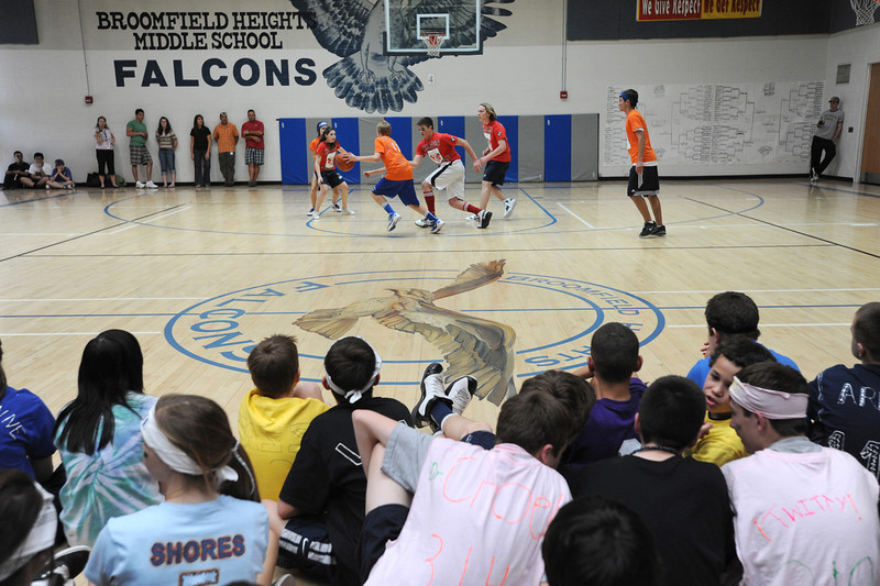Classmates sit on the gym floor to watch the championship game between the teams Linsanity and Crimson Crusaders in the eighth-grade Roundball Rukus 2012 at  Broomfield Heights Middle School on Thursday.<br /> March 15,  2012 <br /> staff photo/ David R. Jennings