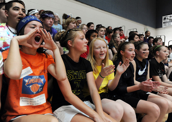 Maiya Mindoro, left , cheers with classmates during the eighth-grade Roundball Rukus 2012 at  Broomfield Heights Middle School on Thursday.<br /> March 15,  2012 <br /> staff photo/ David R. Jennings