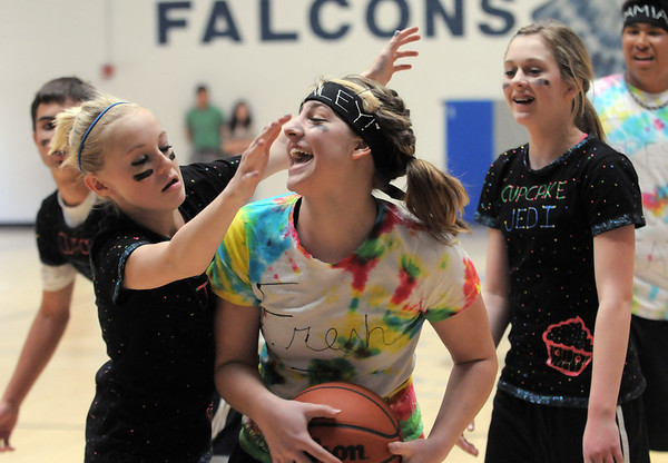 Kaley Vittoria, center, FTD, tries to get the ball past the Cupcake Jedis during the eighth-grade Roundball Rukus 2012 at Broomfield Heights Middle School on Thursday.<br /> March 15,  2012 <br /> staff photo/ David R. Jennings