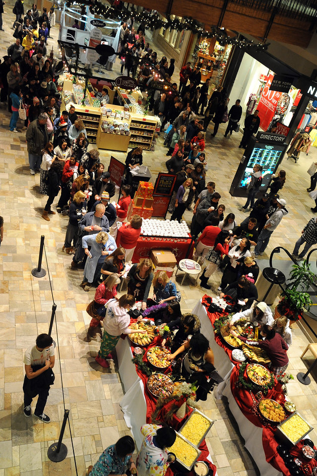 "Black Friday at Flatiron Crossing62.JPG Hundreds of shoppers wait in line for the pajama breakfast in from of Macy's at 6 a.m.<br /> Black Friday shoppers hit the stores by 5 a.m. at Flatiron Crossing in Broomfield.<br /> For a more photos of Black Friday, go to  <a href=""http://www.dailycamera.com"">http://www.dailycamera.com</a>.<br /> Cliff Grassmick / November 26, 2010"