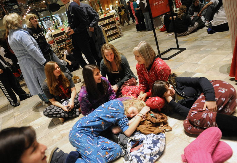 "Black Friday at Flatiron Cr.jpg  Brenna Dowdy, bottom left, naps on Emily Dattori, while Kim Dietz, makes a pillow out of Jenna Jarvis. The group was waiting for the 6 a.m. pajama breakfast.<br /> Black Friday shoppers hit the stores by 5 a.m. at Flatiron Crossing in Broomfield.<br /> For a more photos of Black Friday, go to  <a href=""http://www.dailycamera.com"">http://www.dailycamera.com</a>.<br /> Cliff Grassmick / November 26, 2010"