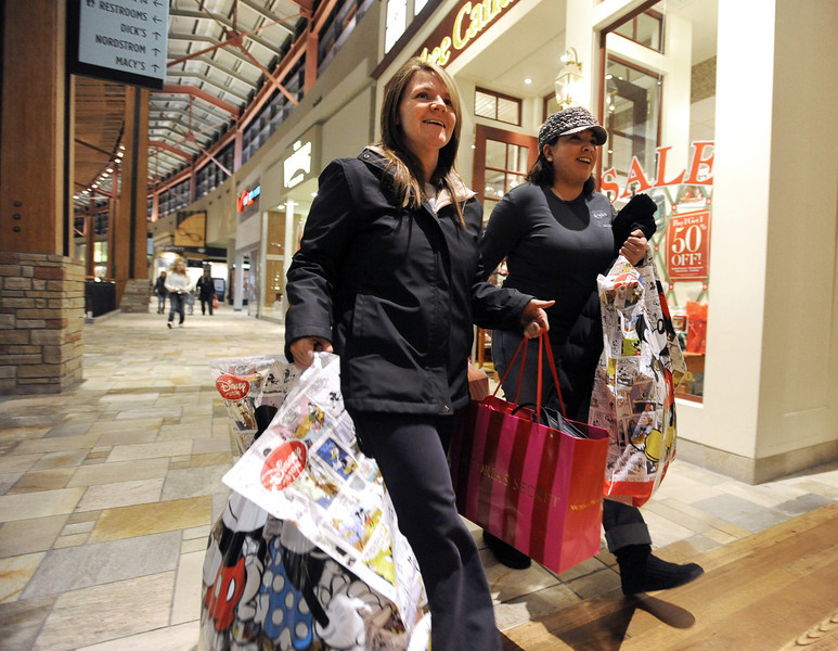 "Black Friday at Flatiron Cr2.jpg Marlo Vigil, left, and Luciana Ruiz, both of Thornton, were weighted down with bags before 6 a.m. Black Friday shoppers hit the stores by 5 a.m. at Flatiron Crossing in Broomfield.<br /> For a more photos and video of Black Friday, go to  <a href=""http://www.dailycamera.com"">http://www.dailycamera.com</a>.<br /> Cliff Grassmick / November 26, 2010"
