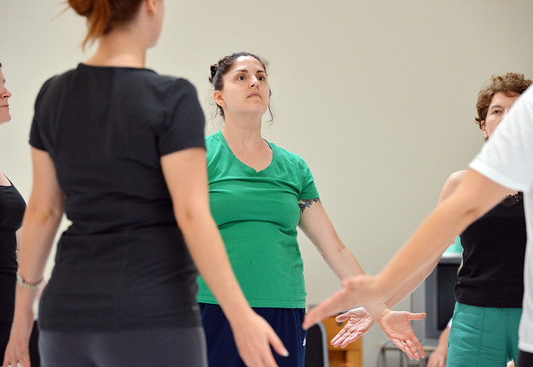 Heather Sutton dances with the adult  dancers during rehearsal for the Adult Community of the School of Ballet Nouveau Colorado Showcase on Saturday.<br /> <br /> July 14, 2012<br /> staff photo/ David R. Jennings