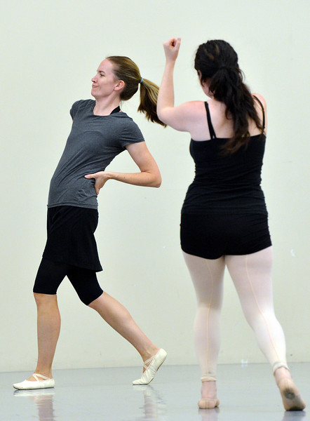 "Alexis Ball , left, dances past Anna Slade while rehearsing "" Flashback""  for the Adult Community of the School of Ballet Nouveau Colorado Showcase on Saturday.<br /> <br /> July 14, 2012<br /> staff photo/ David R. Jennings"