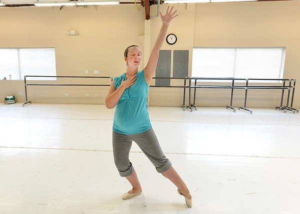 "Kristil Krug rehearses the collaborative dance,  "" I Am""  for the Adult Community of the School of Ballet Nouveau Colorado Showcase on Saturday.<br /> <br /> July 14, 2012<br /> staff photo/ David R. Jennings"
