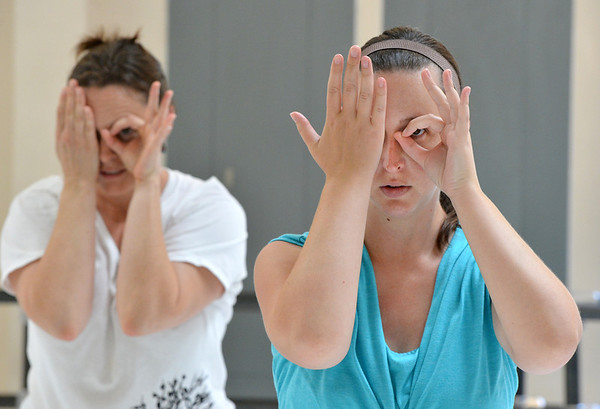 "Kristil Krug, right, and Beth Collier-Fogdall make a sign for art while rehearsing "" I Am"" for the Adult Community of the School of Ballet Nouveau Colorado Showcase on Saturday.<br /> <br /> July 14, 2012<br /> staff photo/ David R. Jennings"