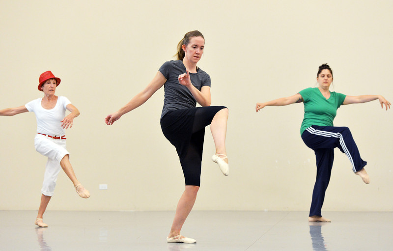 "Alexis Ball , center, dances with Karen Shanley, left, and Heather Sutton while rehearsing "" Flashback""  for the Adult Community of the School of Ballet Nouveau Colorado Showcase on Saturday.<br /> <br /> July 14, 2012<br /> staff photo/ David R. Jennings"