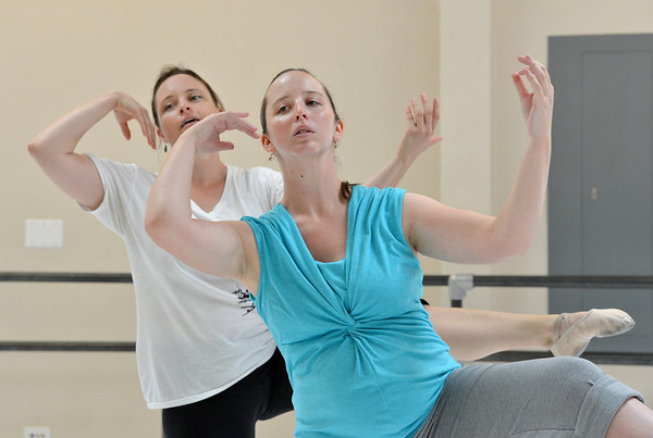"Kristil Krug, front and Beth Collier-Fogdall rehearse "" I Am"" for the Adult Community of the School of Ballet Nouveau Colorado Showcase on Saturday.<br /> <br /> July 14, 2012<br /> staff photo/ David R. Jennings"
