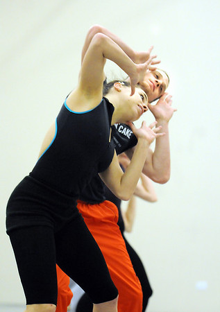"""Dancers Elizabeth Towles and Jason Franklin rehearse """"Beautiful Winter"""" choreographed by Sarah Tallman, one of 5 works by company members and artistic director Garrett Ammon, for Ballet Nouveau Colorado's production of Love.<br /> <br /> January 27, 2010<br /> Staff photo/David R. Jennings"""