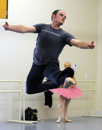 David Barbour leaps in the air while rehearsing the Sugar Plum dance with Sarah Tallman for Ballet Nouveau Colorado's production of The Nutcracker at BNC on Wednesday.<br /> December 2, 2009<br /> Staff photo/David R. Jennings
