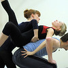 "Julie King, center, moves over the back of Corbin Kalinowski with Julia Meng as they dance together during rehearsal of Ballet Nouveau Colorado's Love in the Digital Age on Saturday.<br /> For more photos please see  <a href=""http://www.broomfieldenterprise.com"">http://www.broomfieldenterprise.com</a><br /> January 21, 2012<br /> staff photo/ David R. Jennings"